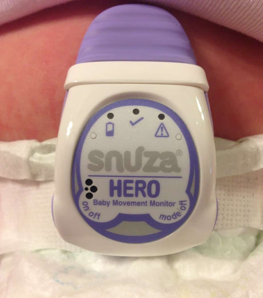 Close diaper and fold down the top, then clip on the Snuza. It's delightfully simple with one button to turn on, two to turn off.